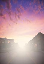 glow of light at sunset over a neighborhood street