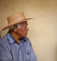 Hispanic man in a straw hat.