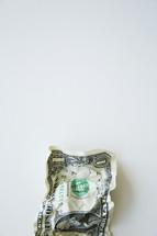 crumpled dollar bill