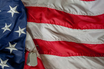 American flag, and military dog tags