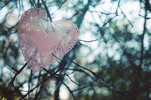 a heart doily in a tree