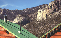 cabin roof and mountain peaks