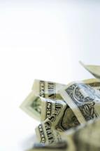 crumpled dollar bills
