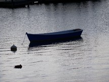 A now empty boat lies floating empty surrounded by still water. One can't help but picture Jesus during his ministry when he went out on a boat to minister and preach to the people. How many hours the disciples and Jesus spent fishing for fish on boats like this and became fishers of men off the shores of Galilee.