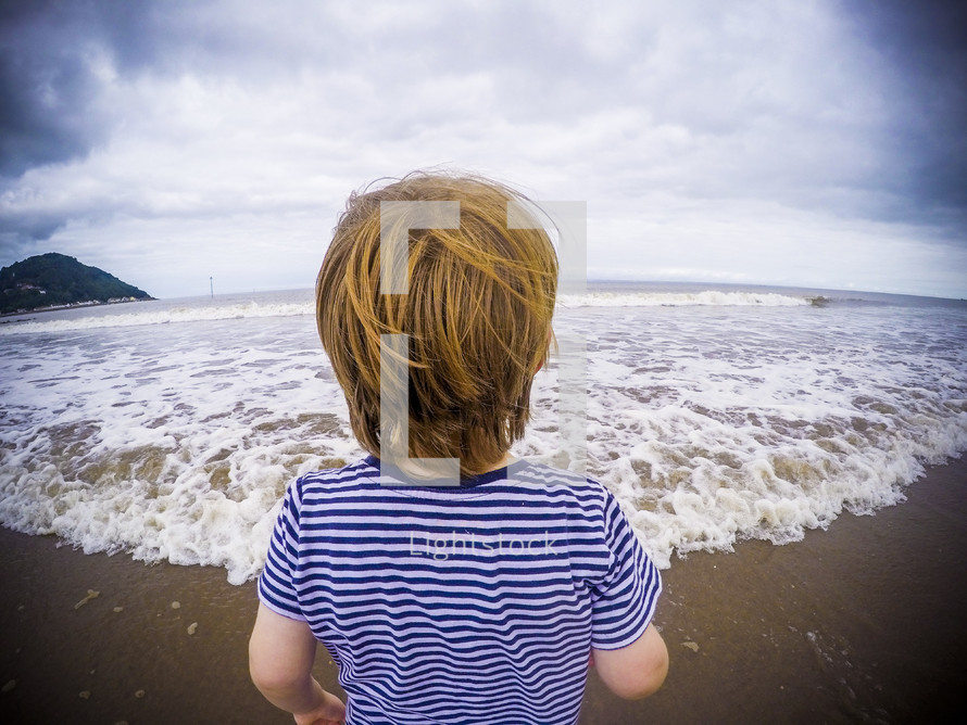 a child walking on a beach