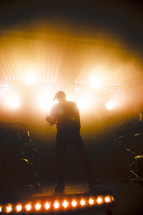 man on stage