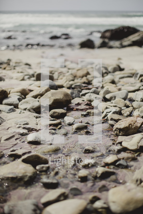rocks on the beach shore