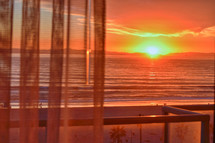 sunset through curtains at Huntington Beach, California