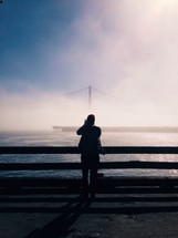 man and fog and the Golden gate bridge