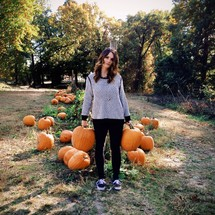 woman in a pumpkin patch