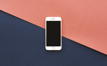 iPhone on a red and navy background