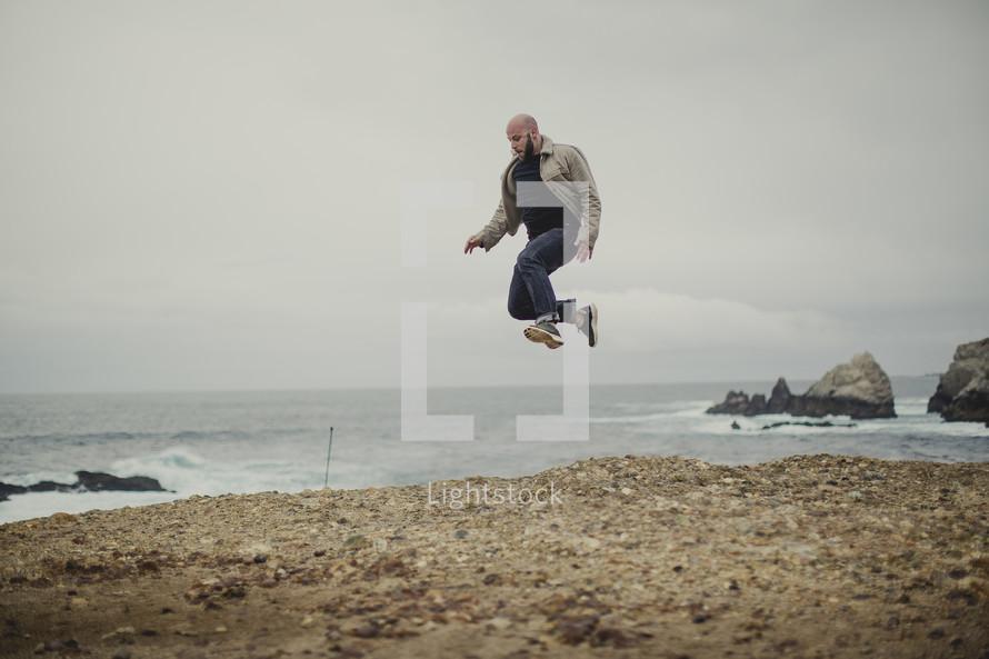 man jumping on the beach