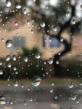 rain droplets on window glass during a rain storm