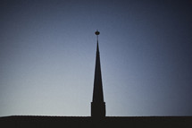 A silhouette of a church steeple