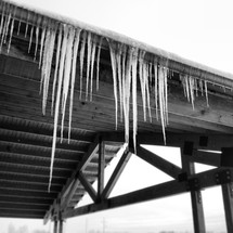icicles hanging from a gutter