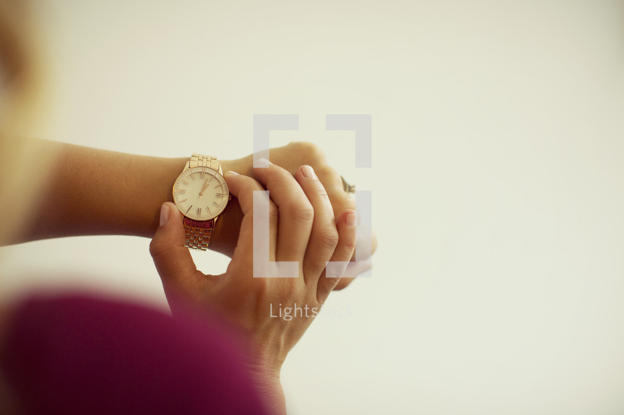 woman checking time on a watch.