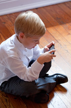 boy playing games on a cellphone