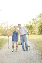 Couple with fishing rods - kissing