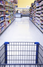 grocery cart in the aisles of a grocery store
