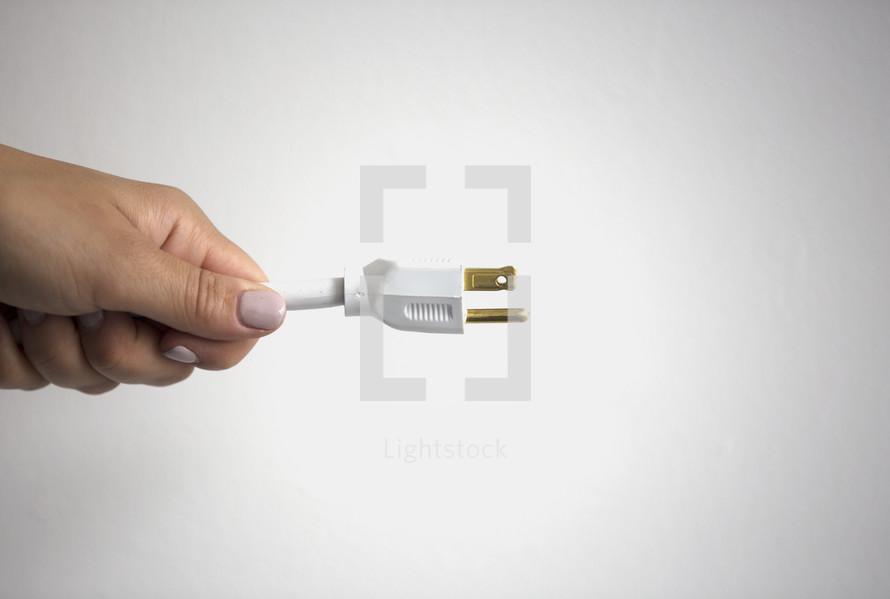 man holding a plug
