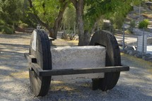 This wheeled cart was the kind of tool used to move large quarried stones into position for building in ancient times