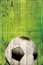 soccer ball and field on a wooden sign