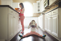 girls in pajamas a kitchen