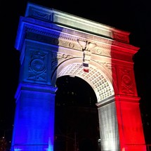 Arc de triomphe in blue, red, and white light