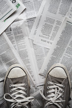 pair of shoes on top of newspaper.