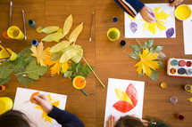 Kids draw and paint leaves in art class.