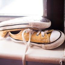 converse sneakers in a window sill