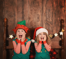 surprised children in elf costumes