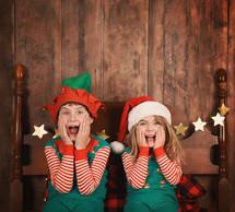surprised children in elf costumes