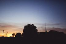 a church steeple at dusk