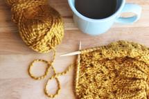 knitting with yarn and a coffee mug