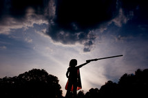 silhouette of a child in a cape