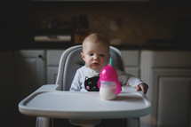 a baby sitting in a high chair
