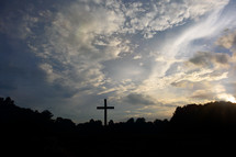 silhouette of a cross in the sky