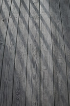 shadows on a wood deck