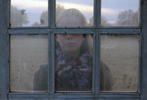 girl child looking into a window