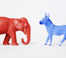 Red Republican elephant and blue Democratic donkey.