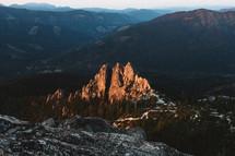 sunlight illuminating a rock peak