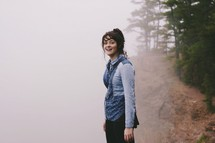 woman standing in fog
