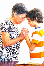 grandmother and grandson holding hands praying