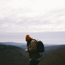 man backpacking