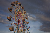 ferris wheel and clouds in the sky