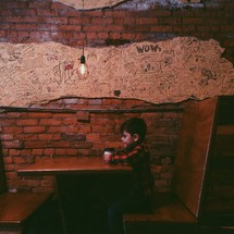 child sitting at a booth at a restaurant