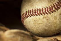 a baseball in a glove.