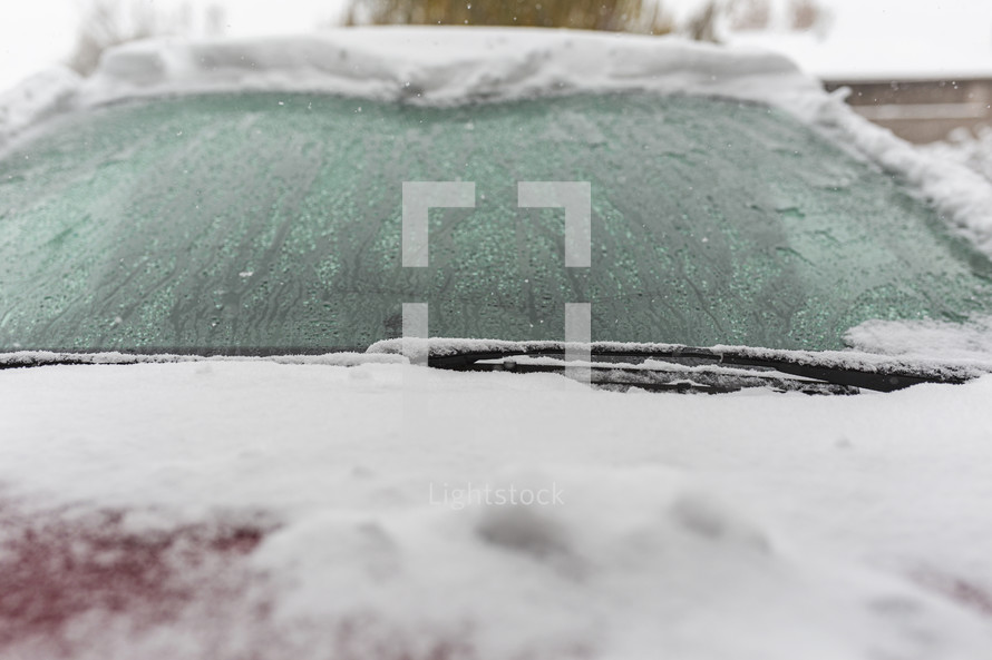 snow covered wet windshield