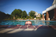 a child in a goggles in a swimming pool